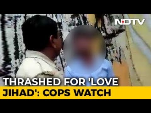New Video Of Meerut Woman's Muslim Friend Being Beaten As Cop Watches