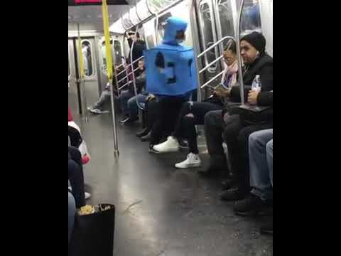 Human Dreidel spinning on NYC Subway