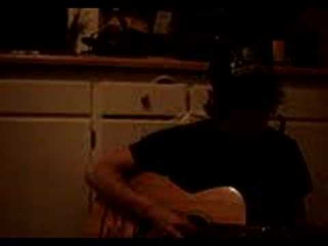 "Adam Gnade playing ""Farmhouses"" in a kitchen. Adam Gnade pla"