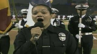 Police Officer Rosalind Iams sings anthem