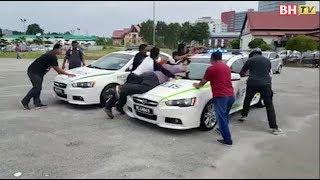 Sekumpulan lelaki merusuh, tendang kereta polis