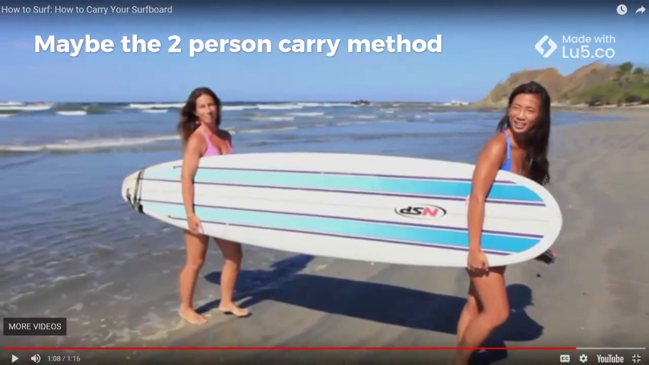 How to carry your surfboard.