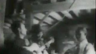 Woody Guthrie-This Land Is Your Land
