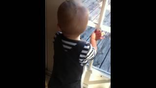 Liam telling for dada outside