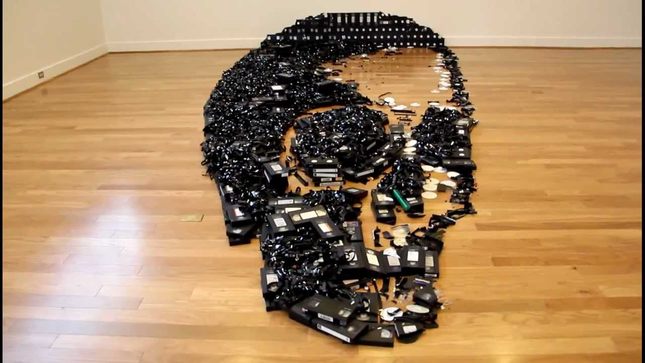Huge Skull Made From VHS Tapes And CDs Is A Fitting Afterlife For Dead Media