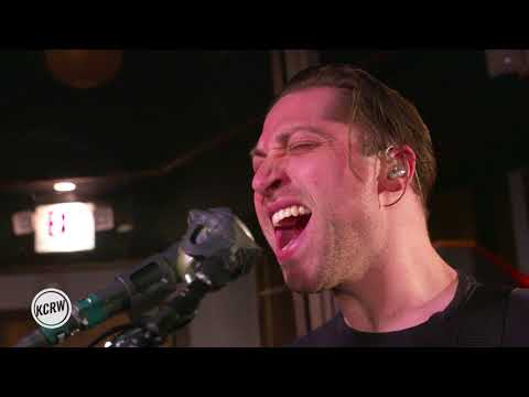 """Queens Of The Stone Age performing """"The Evil Has Landed"""" Live on KCRW"""