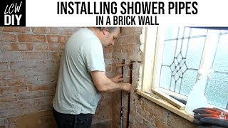 How to Install Shower Pipes in a Brick Wall - Bathroom Renovation 04 - DIY Vlog #19