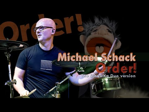Michael Schack & KJ Sawka play 'Order' Live - Viral Brexit drummer hit song @ The UK Drum Show