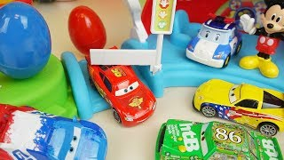 Cars and Robocar Poli car toys Mickey Mouse slide with surpise eggs play