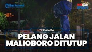 Cegah Warga Berkerumun untuk Berfoto, Pelang Jalan Malioboro Ditutup Terpal