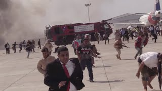 video: Explosions greet new 'unity' government at key Yemen airport