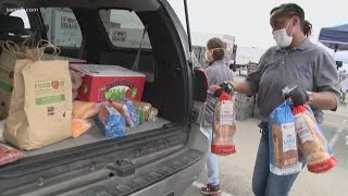 Thousands lined up at the Alamodome to get food for their families
