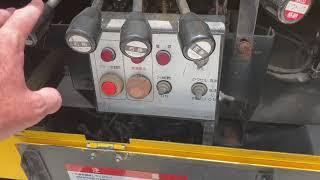 Bucket lift controls explained on the Daihatsu Kei bucket truck