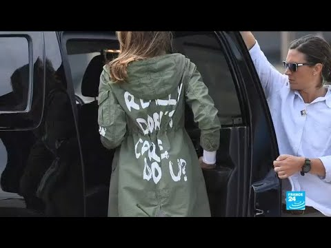 US - First Lady Melania Trump boards flight with a rain jacket written