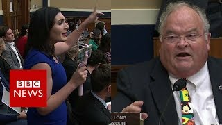 Congressman 'auctions' shouting protester out of hearing - BBC News