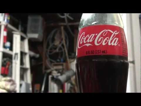 How To Turn A Glass Coke Bottle Into An Adorable Plant Waterer