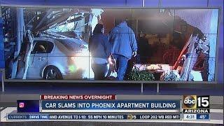 Car slams into Phoenix apartment building