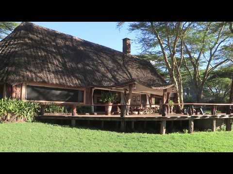 A virtual tour walking through the Sirikoi Cottage - a luxury, two bedroom cottage with inter-leading rooms, both with en suite bathrooms, and a living and dining space in the center.