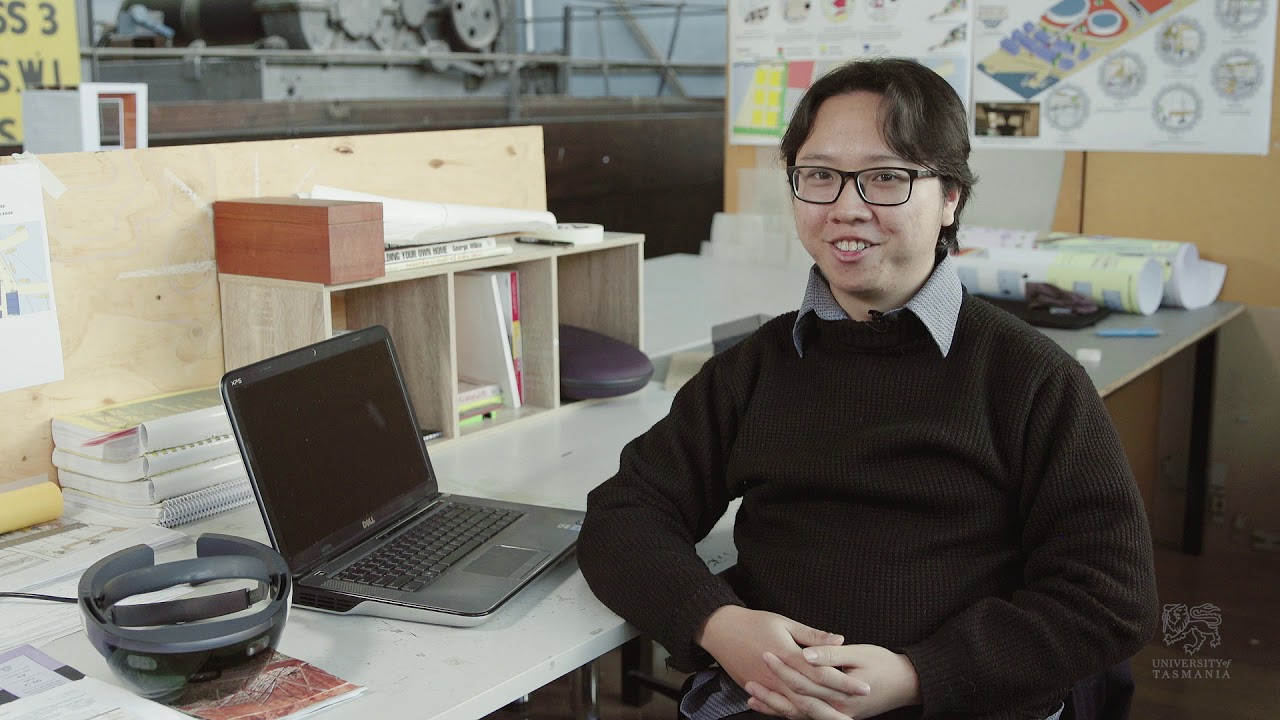 Alan, Master of Architecture student sitting at workstation