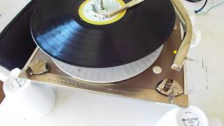 Motorola Stereo record changer playing a LP, 33.3 RPM record.