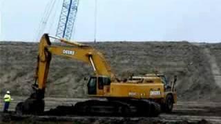 Deere 800C loading CAT 740's (clip 2)