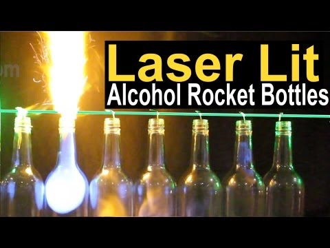 Watch A Laser Light Glass Bottles On Fire