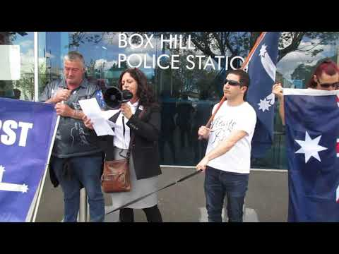 Susan Jakobi speaks against the raising of the Chinese flag at Box Hill Police Station