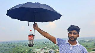 Can an Umbrella save this Coca cola   क्या छाता coldrink को फूटने से बचालेगा