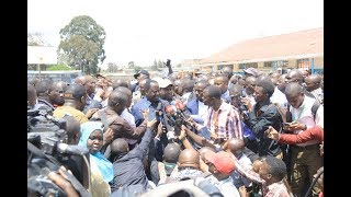 KTN News Reporter enjoys beans and chapatis during Kibra By-election coverage