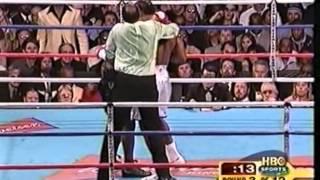 54.Mike Tyson - Lennox Lewis