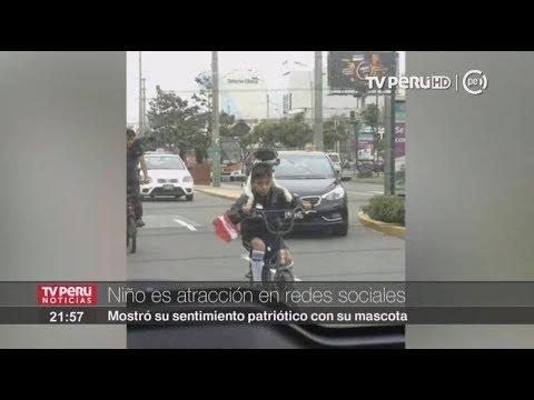 Niño que pasea en bicicleta junto a su perra es la sensación de las redes sociales