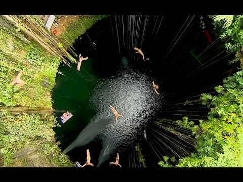 Group Cliff Dive into the Ik Kil Cenote