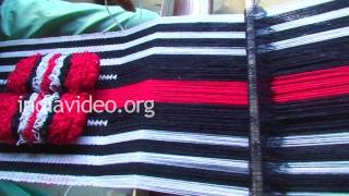 Village woman weaving a Naga shawl