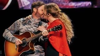 Kelly Clarkson's husband Brandon Blackstock surprises her on stage as she sings Piece by Piece