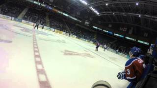 Victoria Royals Joe Hicketts hits Edmonton Oil Kings captain Brandon Baddock