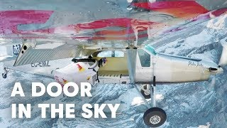 2 wingsuit flyers BASE jump into a plane in mid-air.   A Door In The Sky