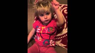 Little deaf girl having a try at signing Little Donkey Christmas carol in sign language.
