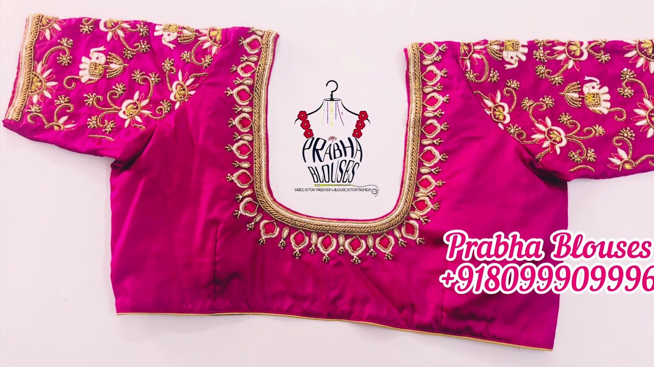 """<p style=""""color: red"""">Video : </p>Pink Bridal Blouse With Elephant And Peacock Work 