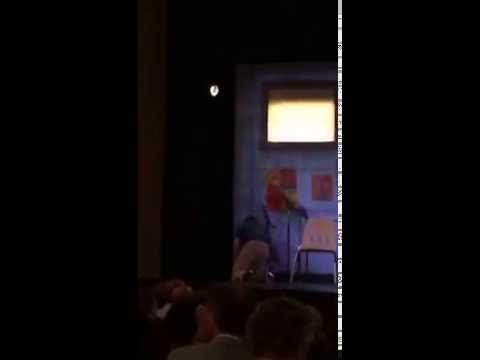 Moron jumps on stage on Broadway to try and charge his phone in a fake outlet