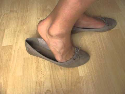 beige ballerinas and nylons, shoeplay and dangling