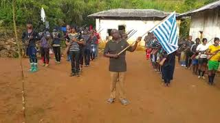 Colonial Administrator with the Southern Cameroon flag adhering to the Anthem