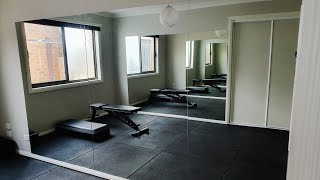 Gym mirror installation. How to hang mirrors on a wall with glue.