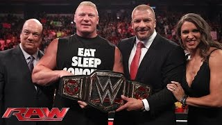 Brock Lesnar receives the new WWE World Heavyweight Championship: Raw, Aug. 18, 2014