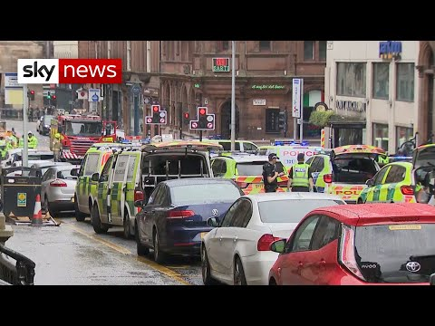 man shot dead by police after glasgow stabbing attack