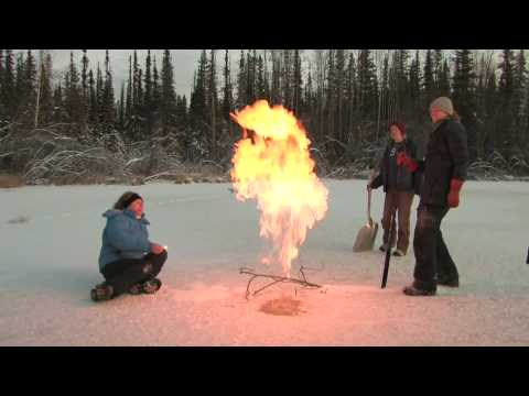 University of Alaska Fairbanks Professor Katey Walter Anthony lights methane gas on fire as it escapes frozen Arctic lake