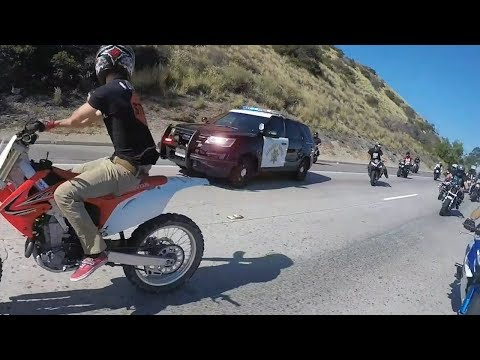 Cop tries to stop group of bikers.. Then this happens....