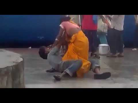 Women Beating Her Husband Publicly