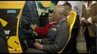 Prince Charles playing an arcade game