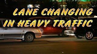 LANE CHANGING IN HEAVY TRAFFIC