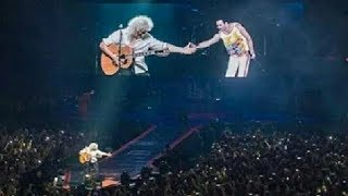 Brian May Cries While Shaking Hands With Imaginary Freddie In Concert